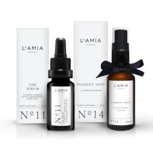 Set de serum y crema antimanchas en botella de cristal marrón de la marca de cosmética natural 100% L'Amia Natura